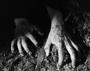 Hands crawling in dirt